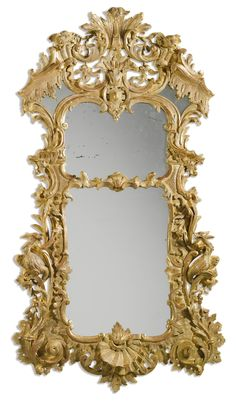 A George II carved giltwood pier mirror in the manner of Matthias Lock, circa 1745