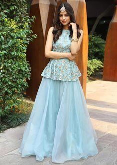 Turq blue halter neck peplum top with matching organza skirt only on KalkiYou can find Designer dresses indi. Sharara Designs, Choli Designs, Lehenga Designs, Kurti Designs Party Wear, Indian Gowns Dresses, Indian Fashion Dresses, Dress Indian Style, Indian Designer Outfits, Party Wear Indian Dresses