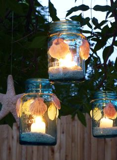 blue mason jars with decorated with shells...