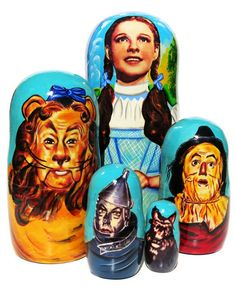 """This nesting doll is handmade and painted in the Russian Federation. The nesting doll features hand painted original caricatures of the famous 1939 movie """"The Wizard of Oz"""". The most famous characte"""