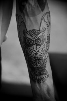 Cool owl tattoo...and I don't even really like owls
