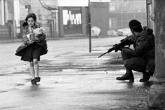"""♥ Harry Benson ♥ Girl and British Soldier, Belfast, Ireland Harry Benson, War Photography, Documentary Photography, Inspiring Photography, British Soldier, British Army, Northern Ireland Troubles, Irish Republican Army, Carpe Diem"