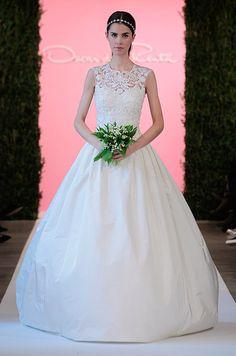 This Oscar de la Renta ball gown features a beautiful illusion neckline.
