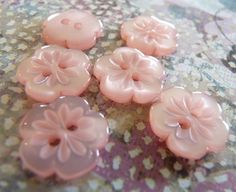 love these little glass pale pink buttons