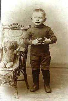 Vintage photo of a little boy with his Teddy Bear circa 1890 - 1910.