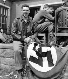 USAAF officer poses with a Swastika flag for the photographer. Unknown location and date, most probably 1945.