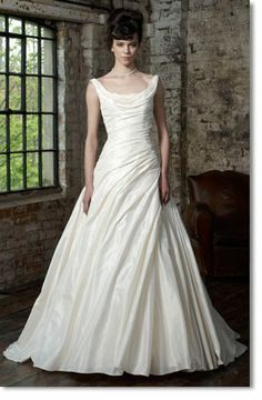 Wedding dress - a-line, full skirt with  asymmetrical ruching/draping on the bodice and scooped neckline. Not really what I had in mind, but simple and beautiful