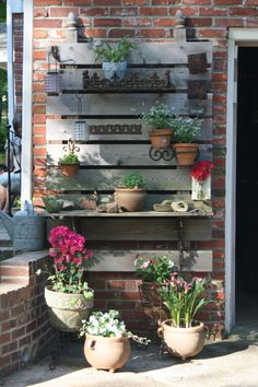 This might a great solution to add structure to the siding chimney for for my statuary hanging and vines! | potting bench
