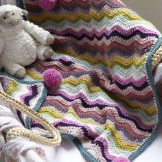 How to make a cosy crocheted buggy blanket: This comfy crocheted blanket can be made in a rainbow of different colours and is just the right size to keep the little one tucked snugly in a stroller or car seat.