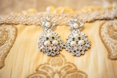 What gorgeous earrings and bridal necklace!  ::Erin + Eric's delightful wedding at the Cathedral of Christ the King in Atlanta, Georgia:: accessories, sparkle, diamonds, pearls