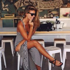 Women's street style for summer: navy and white striped maxi dress, black sandals ray ban wayfarer sunglasses