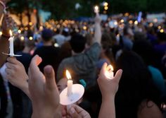 Supporters of the victims of the recent mass shooting at the Pulse nightclub hold up candles while attending a vigil at Lake Eola Park, Sunday, June 19, 2016, Orlando, Fla. Tens of thousands of people attended the vigil.