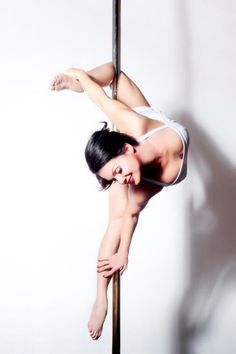 Lovely pose..from a Seven, or just a knee flip, swing unattached leg to other side of pole, grab top foot, and arch back