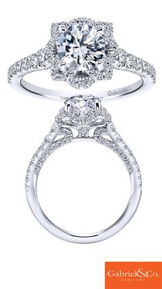 A beautiful Amavida Bridal 18k White Gold Diamond Halo Engagement Ring from Gabriel & Co. This gorgeous piece has such amazing diamonds and details. The designs underneath the center stone add such uniqueness to the engagement ring that makes it so different and special!