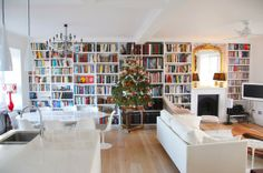 I think this is what we should do around our fireplace-- a book wall!   A Fantastic London Flat in the Shadow of Big Ben — House Call