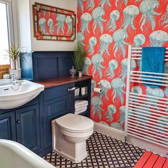 Bathroom makeover Colourful family bathroom with red jelly fish wallpaper How The Medieval English P Blue Modern Bathrooms, Funky Bathroom, Bathroom Colors, Small Bathroom, Wall Paper Bathroom, Glitter Bathroom, Red Bathroom Decor, Fish Bathroom, Colorful Bathroom