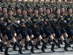 A unit of women soldiers march in formation.