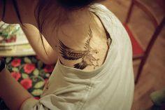Eagle neck tattoo
