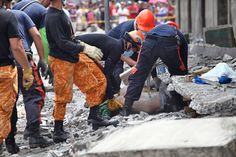 CEBU, Philippines - A powerful earthquake killed at least 93 people in the Philippines Tuesday as it generated landslides that buried homes, triggered terrif. Philippines Earthquake, Visayas, Emergency Medical Services, Cebu, Ghana, Death, Life, Women's Side Tattoos, Men's Fitness Tips