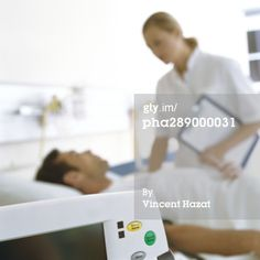Stock Photo : Nurse checking on patient