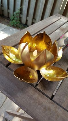 Lotus tealight holder.  Available for $15 each plus shipping... perfect for a centrepiece for weddings for small restaurants Small Restaurants, Ethnic Home Decor, Tea Light Holder, Wedding Centerpieces, Tea Lights, Lotus, Candle Holders, Bling, Candles