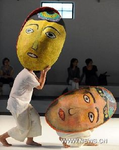 """Actors perform during a rehearsal  """"Who's Hung Tung"""", a performance inspired by Taiwanese famous painter Hung Tung's (1920-1987) designs. Songshan Cultural and Creative Park in Taipei, Taiwan, 2011. (Xinhua/Wu Ching-teng)"""