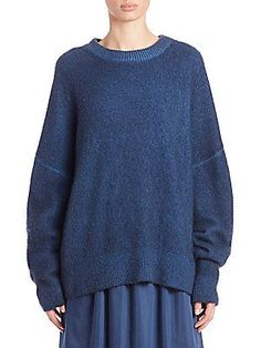 "The Row Tinto Cashmere & Silk SweaterOversized silhouette knit in cashmere-silk blend Ribbed crewneck, cuffs and hem Dropped shoulders Long sleeves Pullover style About 25"" from shoulder to sapphire"