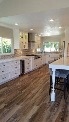 Love my custom white shaker cabinets, quartz countertop, wood look tile and new peninsula. The gray arabesque backsplash ties it all together. Couldn't be happier with my dream kitchen!