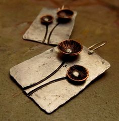 metal earrings plus lots of metal jewellery inspiration on this ETSY shop