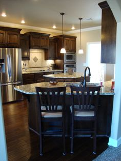 dark cabinets, dark floors, light counter & stainless-- perfection!