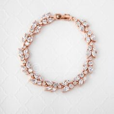 A classic design that will match many earrings styles, this bridal bracelet is designed with round, pear and marquise CZ jewels set in rose gold. It is 7 inche