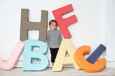Giant foam alphabet letter pillow DIY: If you really want to go to town with name decorating, why not make some superlarge alphabet pillows for your kids' rooms? These giant ones are crafted from soft foam, but you could also use fabric and make them smaller to display on a shelf, sofa, or bed following this DIY.
