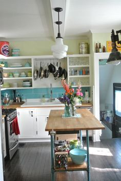 Coveting: the island, the lighting, the open cabinets. farm fresh therapy: our budget kitchen renovation