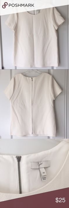 Joie cream short sleeve top Size M. Semi-hidden zipper up entire back. Darts in front. 100% wool. Lined. Great condition. Smoke free home. No trades. All offers considered. Joie Tops Blouses