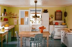 Such a cute little kitchen, with lots of great color combos. via Rita Konig