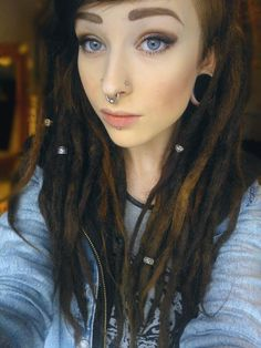 I'm kinda in love with dreads lately.  Might add a few into my hair when it gets long enough.