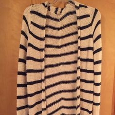 Free People Beach Striped Cardigan Free People Beach Striped Cardigan. Ivory with navy stripes. There are pockets at the bottom. This cardigan fits snug through the sleeves, and is about to the knee/mid thigh in length. Never worn! Perfect condition! Free People Sweaters Cardigans
