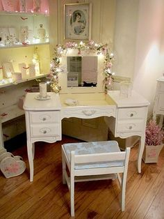 Such a cute little vanity...I love the ones that have an open up drawer on top for the mirror. ᘡղbᘠ