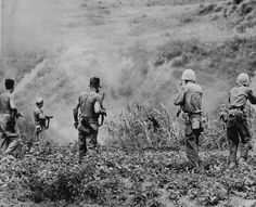 Japanese soldier surrenders to Marines in Cane Field Okinawa