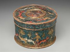 Marriage box about 1400–25 Circular box formed of bent wood, entirely painted. Exterior oainted with hunting scenes and two coats-of-arms in center of cover. Interior painted red. Slightly chipped edges.