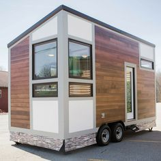This is the Degsy Tiny House by 84 Lumber Tiny Living. It's a 160 sq. modern looking tiny home on wheels with a slanted roof. Inside, you'll find a… Small Tiny House, Modern Tiny House, Micro House, Tiny House Living, Tiny House Plans, Tiny House On Wheels, House Floor Plans, Tiny House Exterior Wheels, Tiny Tiny
