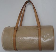 Louis Vuitton vernis leather 'Bedford' bag. Beige, patent leather barrel shape bag with 2 leather straps & top zip. Features 1 outside pocket on side of bag. Leather inside with no pockets.