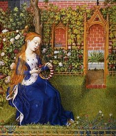 Woman crafting in medieval garden. She is wearing a surcoat and a sideless surcote adorned and lined with fur.