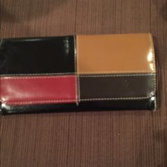 Multi colored wallet Like new! Multi colored wallet. Will go with any outfit. Price firm unless bundled Bags Wallets