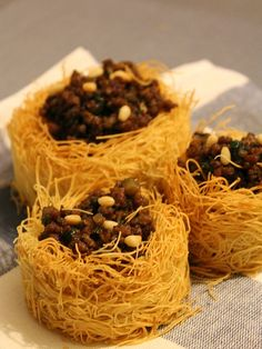 Add a Mediterranean touch to your dinner with these Kataifi nests filled with ground lamb and pine nuts.