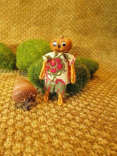 Check out this item in my Etsy shop https://www.etsy.com/listing/261080587/miniature-pumpkin-head-doll