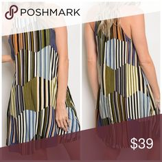 Fully lined halter geo print dress Gorgeous shape and color! Sold out last dresses here! Outer fabric is Rayon lining is poly/ we love this beauty! Fits true to size Dresses