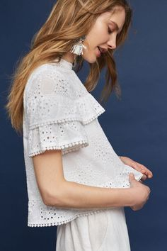 Pretty eyelet top with ruffle sleeves.