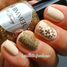 Sparkle gold nails with polka dot design