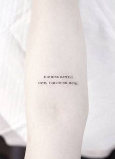 """""""Nothing happens until something moves"""" tattoo on the left inner forearm"""